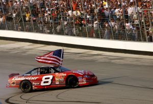 23 Sep 2001: Dale Earnhardt Jr. carries a flag as he burns the tires of his #8 Budweiser Cheverolet Monte Carlo following his win in the MBNA-Cal Ripken Jr. 400 at Dover Downs International Speedway in Dover, Delaware. Digital Image. Mandatory Credit: Jamie Squire/ALLSPORT